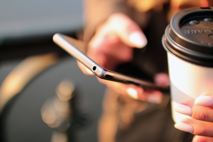 hands-coffee-smartphone-technology-large